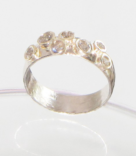 hand forged white gold wedding ring with seven diamonds