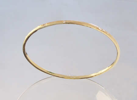 new custom 14k yellow gold handforged bangle