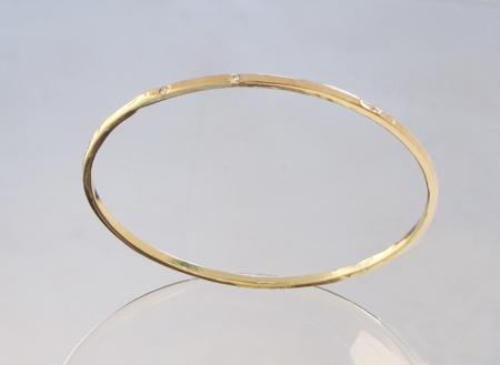 new custom 14k yellow gold handforged bangle